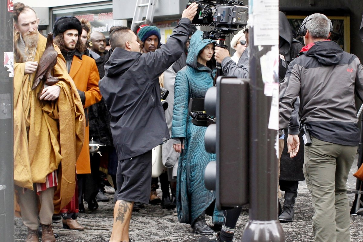"EXCLUSIVE: Jennifer Lawrence wears a blue cloak on the set of ""The Hunger Games: Mockingjay"" in Paris"