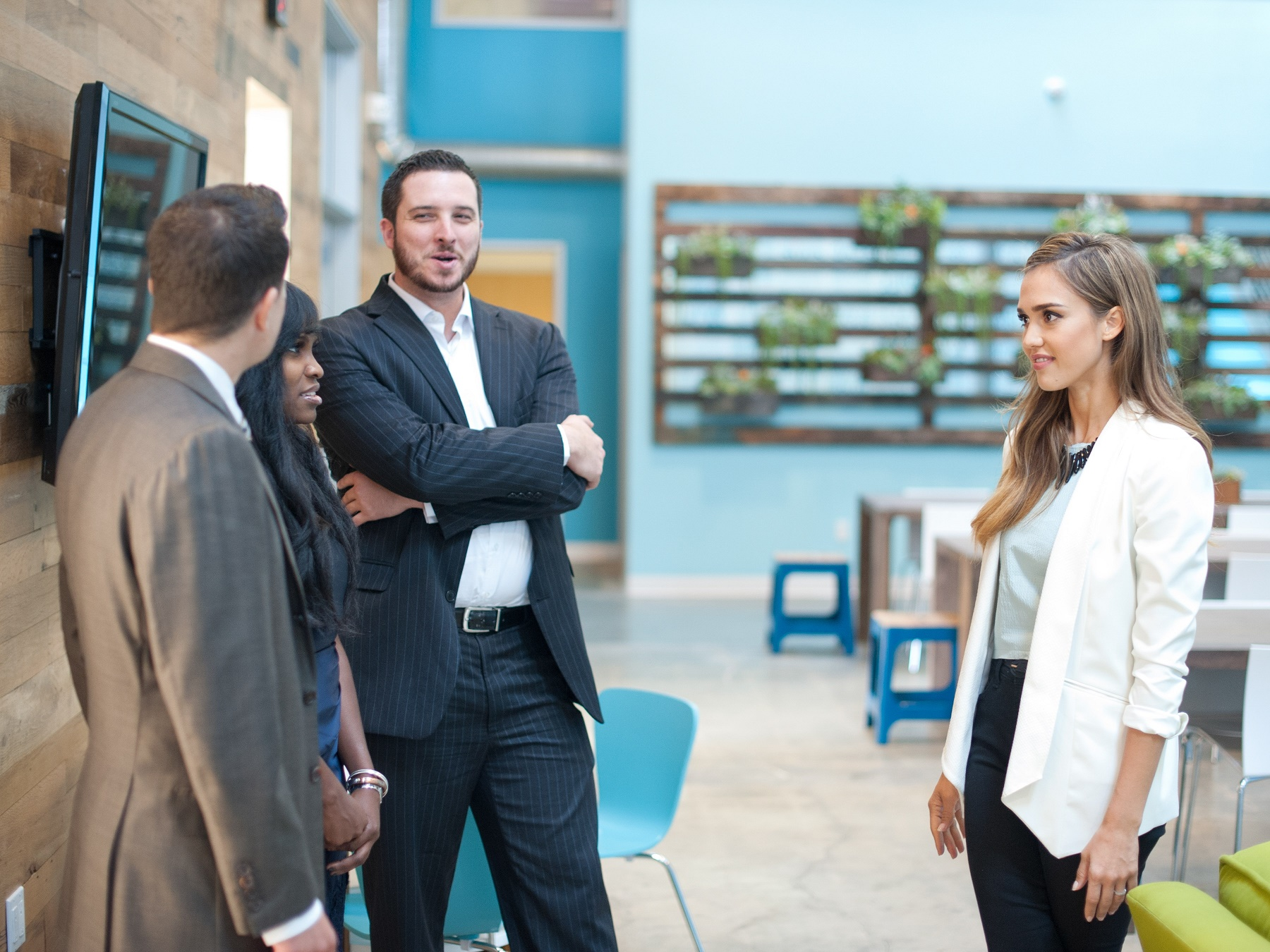 """Correspondent Jessica Alba speaks with Climate Corp Fellows Brendan Edgerton, Jenise Young, and Scott Miller at The Honest Company offices, from the segment """"Climate Corps."""" (Photo Credit: The Years Project/Courtesy of SHOWTIME)"""