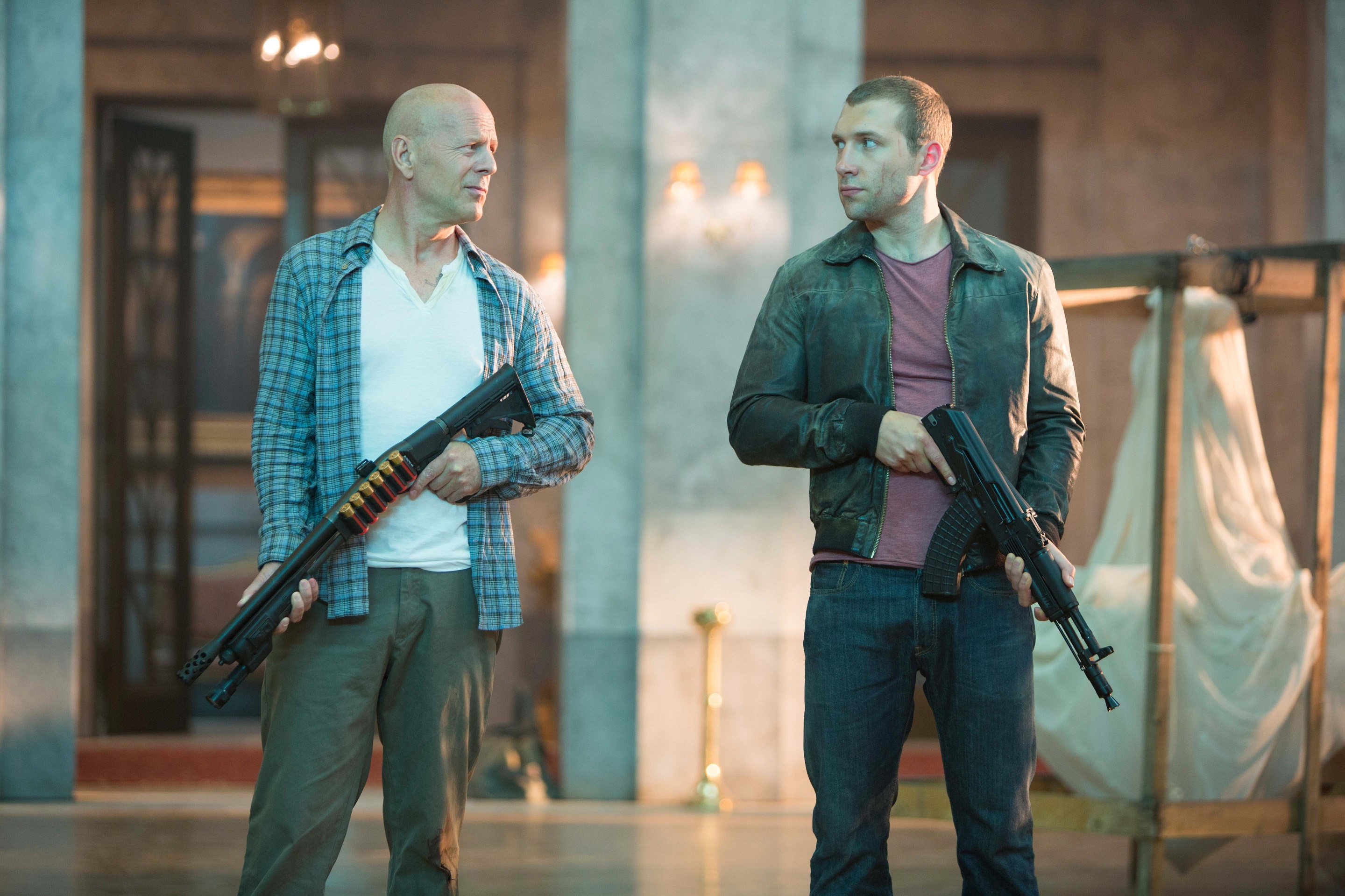 A GOOD DAY TO DIE HARD John McClane (Bruce Willis) and his son Jack (Jai Courtney) unexpectedly join forces to stop a nuclear weapons heist. Photo Credit: Frank Masi, SMPSP TM & © 2013 Twentieth Century Fox Film Corporation.  All Rights Reserved.  Not for sale or duplication.