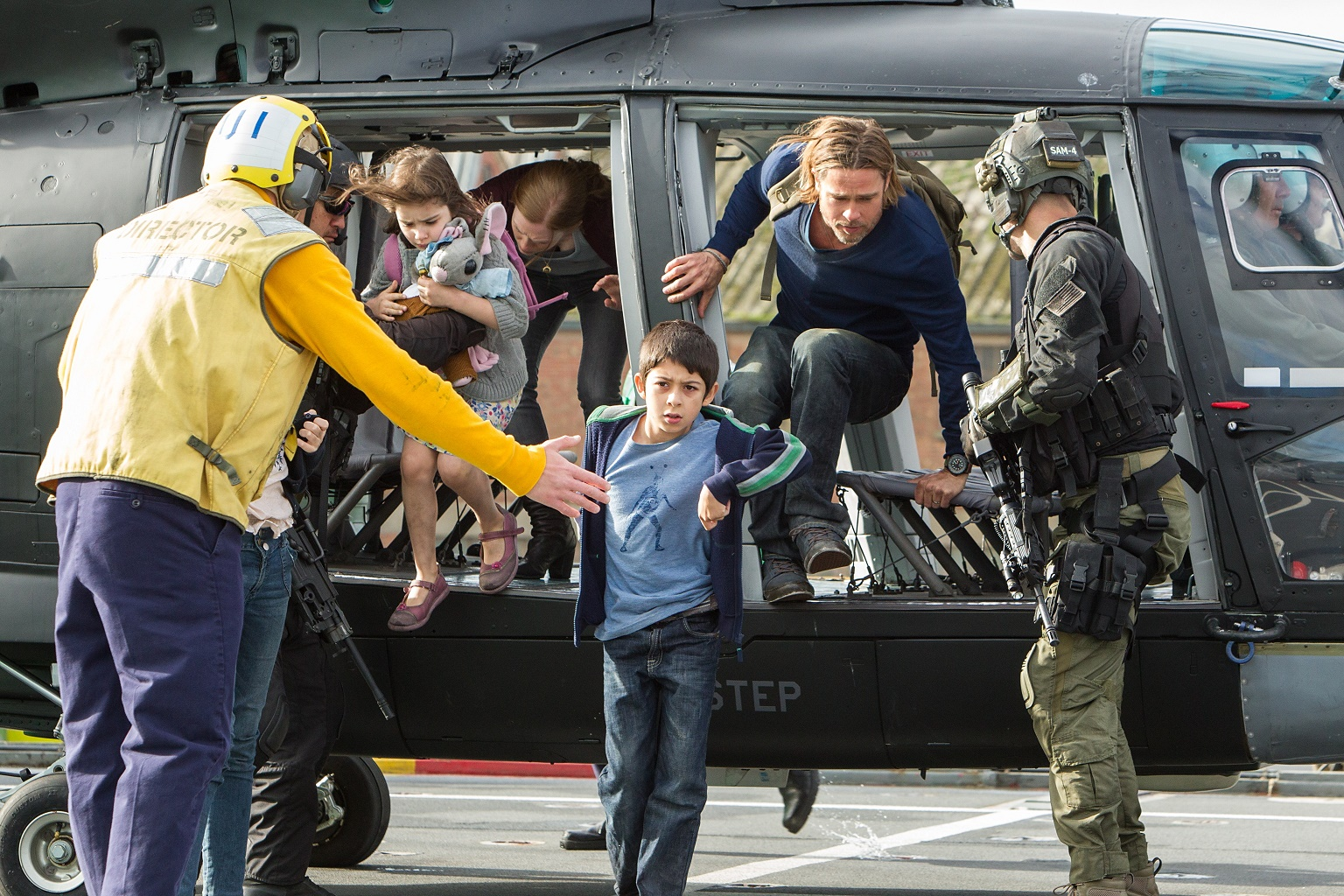 Left to right: Sterling Jerins is Constance Lane, Mireille Enos is Karin Lane, Fabrizio Zacharee Guido is Tomas, and Brad Pitt is Gerry Lane in WORLD WAR Z, from Paramount Pictures and Skydance Productions in association with Hemisphere Media Capital and GK Films. WWZ-03132R