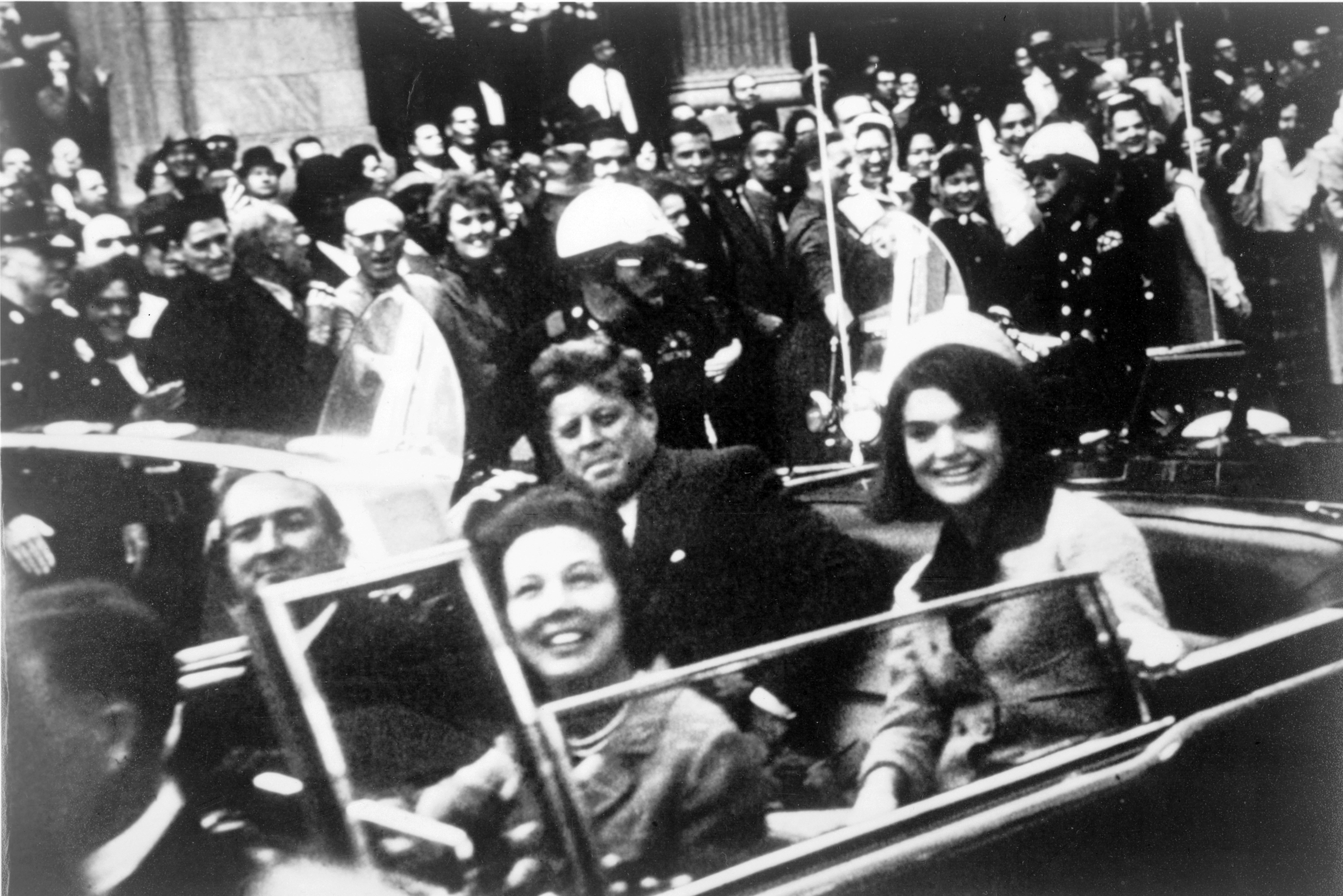 John F Kennedy motorcade, Dallas, Texas USA, 22 November 1963. Close-up view of President and Mrs Kennedy and Texas Governor John Connally and his wife. (photo credit: Universal History Archive/Getty Images)