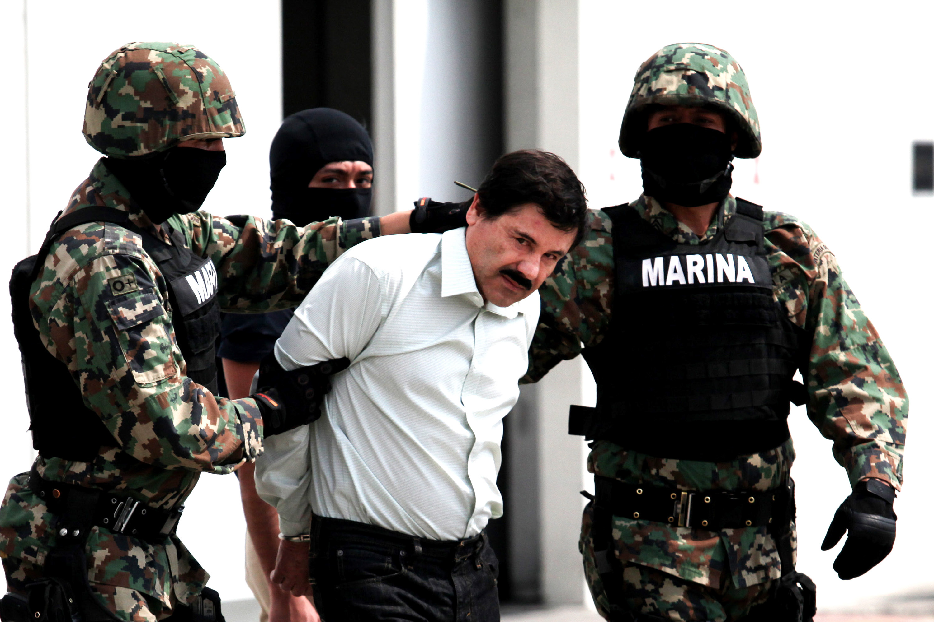 "Mandatory Credit: Photo by Jair Cabrera Torres/NurPhoto/REX/Shutterstock (3601811a) Mexican Navy soldiers escort Joaquin Guzman Loera (front), alias ""El Chapo Guzman"", leader of the notorious Sinaloa Cartel Sinaloa drugs cartel leader Joaquin 'El Chapo' Guzman captured, Mexico City, Mexico - 22 Feb 2014 Mexican President Enrique Pena Nieto on Saturday confirmed the capture of the world's most wanted drug lord, Joaquin Guzman Loera, known as El Chapo, in the Pacific resort of Mazatlan."